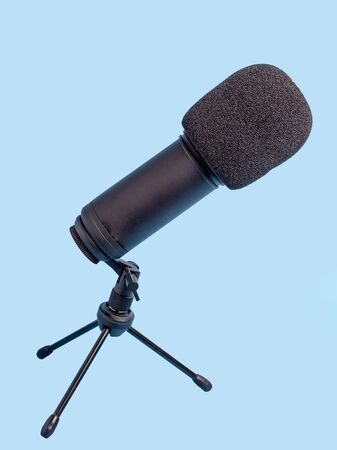 Studio microphone for recording over blue background.