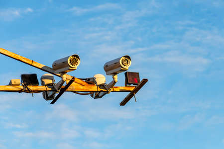Radar speed control camera on the road on blue sky background Imagens