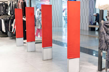 Red racks in the store for inscription for Sale Stock fotó