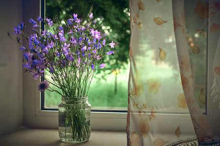 bouquet of blue field wind chimes in the window