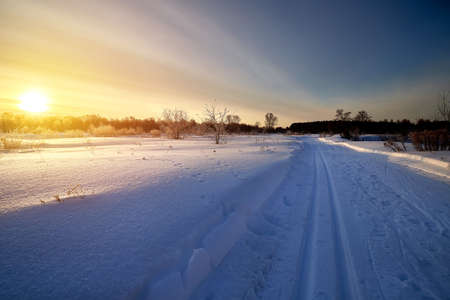Snow covered road or skiing on a winter sunny day Stok Fotoğraf