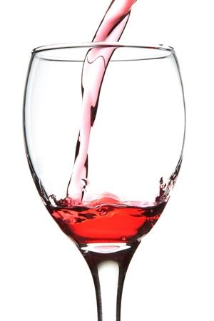 wine pouring: versare il vino rosso nel bicchiere.