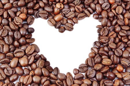 coffee beans in heart shape on white background photo
