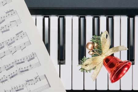 christmas music: Christmas bell on keyboard Stock Photo