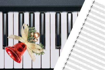 Christmas bell on keyboard photo
