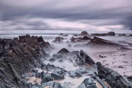 diffuse: Marine rocks in diffuse waves. Portugal. Stock Photo
