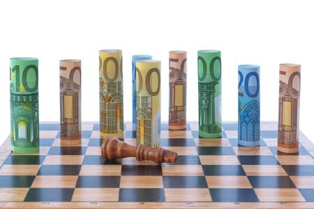 The figure of the money on a chessboard  photo