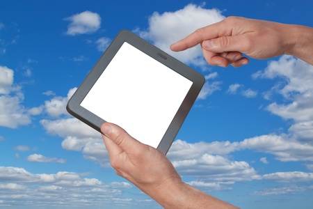 Tablet in hand against the sky. Stock Photo - 12868508