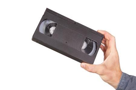 videocassette: Cintas de v�deo, cintas de v�deo en la mano sobre un fondo blanco