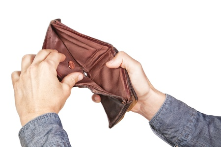 Empty wallet in his hands  On a white background  photo
