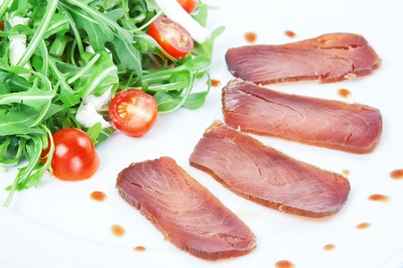 The composition of the slices of smoked tuna. photo