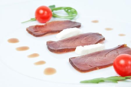 Closeup of slices of smoked tuna. photo