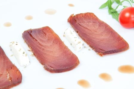 Closeup of the three slices of smoked tuna. photo