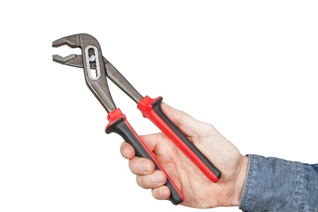 Adjustable wrench in hand, on a white background  photo