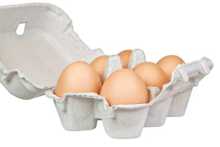 Tray yellow eggs  On a white background Stock Photo - 13195107