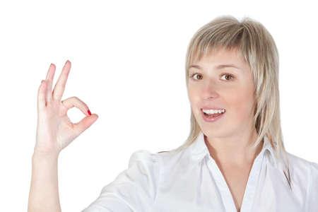 Blonde girl shows ok  On white background Stock Photo - 13195108