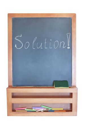 Solution-writing on the blackboard with chalk   photo