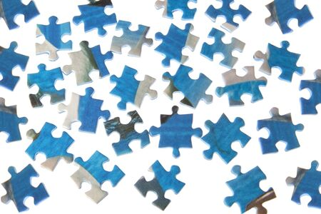 dispersed: Puzzles dispersed on a white background  Stock Photo