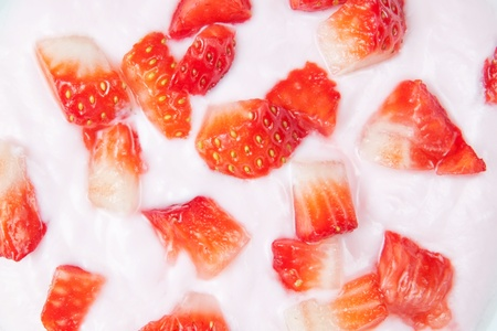 Sliced fresh strawberries in yogurt closeup  photo