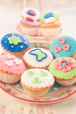 Composition of beautiful decorative baked cupcakes  photo