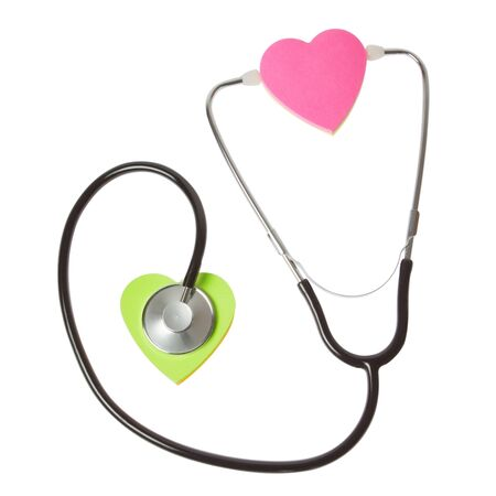 The concept of the heart and the stethoscope  On a white background  photo