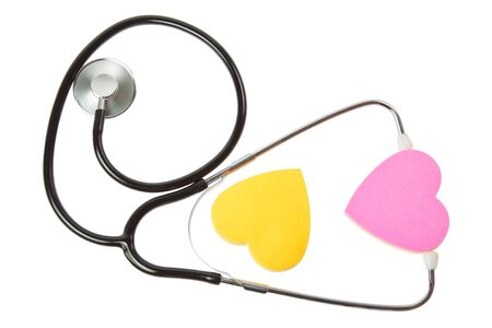Two hearts and a stethoscope  On a white background  photo