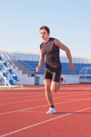 A young man starts running in the stadium  Treadmill  photo