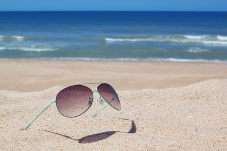 Glasses on the beach  Seascape  photo
