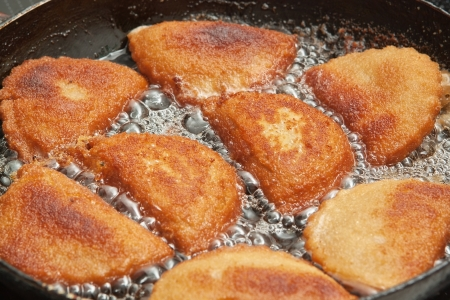 Patties with calamaries in butter in a frying pan  photo