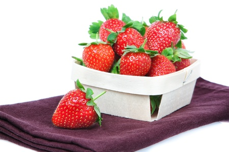 The composition of the strawberries in a basket  photo