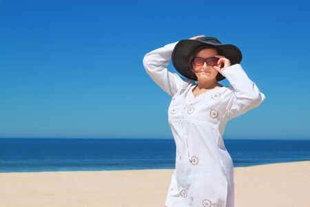 Beautiful girl in the hat on the beach  Stock Photo - 14327874