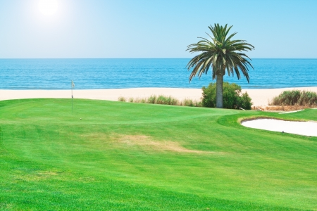 Beautiful summer day on the golf course near the sea  photo