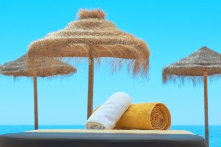 Towels for the spa, on the background of the Portuguese sea  Imagens