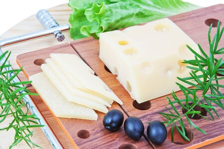 The composition of cheese, lettuce and olives  photo