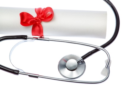 Stethoscope on background of Certificate. Closeup. photo
