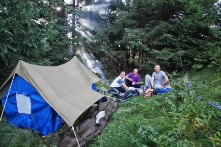 Friends in the campaign with a tent in the Carpathian forest  photo