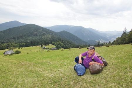 Sedentary tourist in mountains Carpathians  Stock Photo
