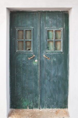 Old green door on the streets of Portugal