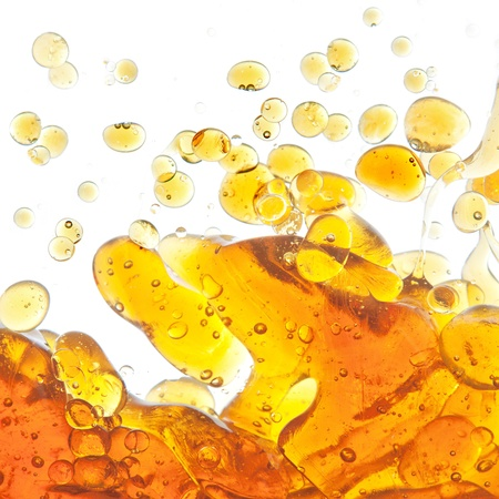 The texture of the bubbles of oil in an abstract form in the water. On a white background.