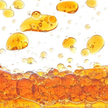 A drop of olive oil in the water in the studio. Standard-Bild