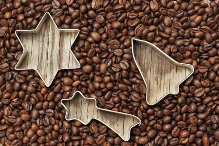Group of Christmas items in coffee beans on a wooden texture  photo