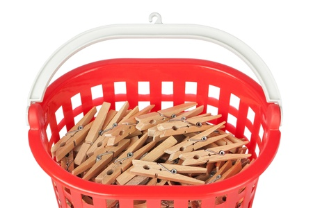 Set of clothespins in the red basket. Closeup. Stock Photo - 16139019
