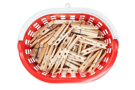 Clothespins in red basket. View from above. Closeup. photo