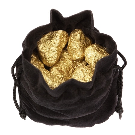 Gold nuggets stones in a bag on a white background.