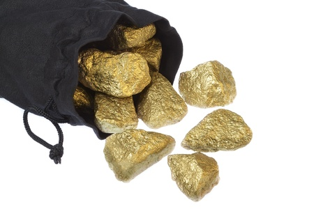 Gold nuggets scattered stones in a bag on a white background.