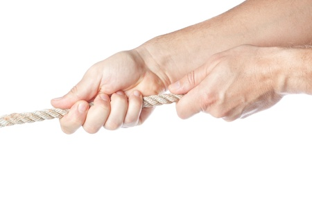 Two hands pulling a rope  On a white background  photo