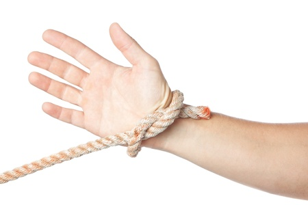 Concept image, tied hand on a white background. photo