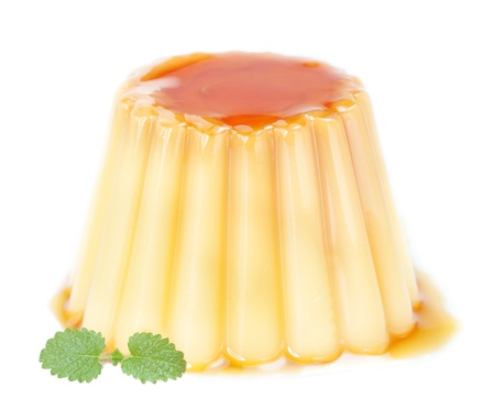 creme: Delicious pudding with caramel and mint leaves  On a white background