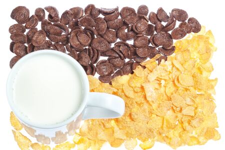 Cup of milk on a background corn flakes and chocolate flakes. photo