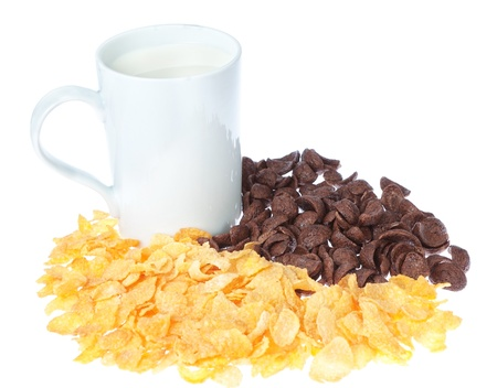 Cup of milk on a background chocolate corn flakes. photo